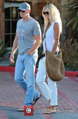 Elle Macpherson and her new boyfriend, financier Roger Jenkins, seem very much in love as they walk around Malibu Country...
