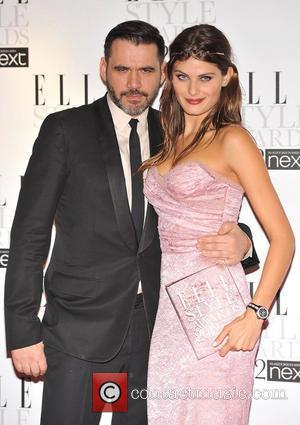 Isabeli Fontana (R) with her 'Best Model' award presented by Roland Mouret (L) ELLE Style Awards held at the Savoy...