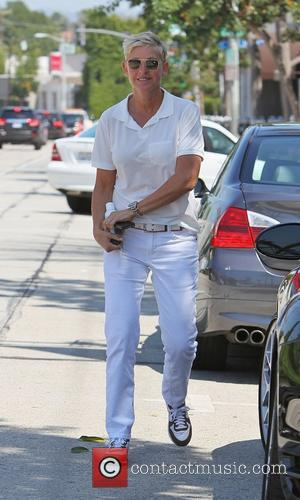 Ellen DeGeneres wearing white jeans, white belt and a white top heads for a spa in West Hollywood carrying a...