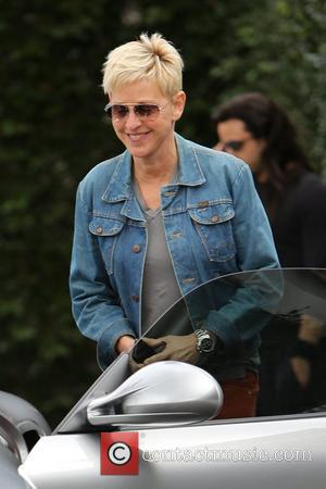 Ellen DeGeneres is all smiles as she returns to her car after eating lunch with a friend at Cecconi's West...