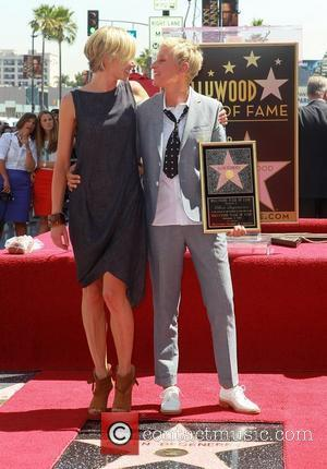 Ellen DeGeneres and Portia de Rossi Ellen DeGeneres is honored with a star on The Hollywood Walk Of Fame Los...