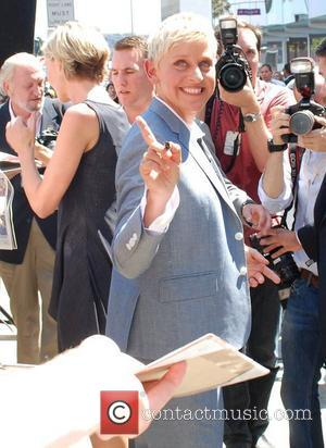 Ellen DeGeneres  signs autographs after being honored with a star on the Hollywood Walk of Fame Los Angeles, California...