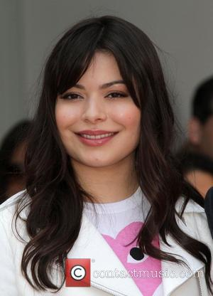 Miranda Cosgrove Radio personality Ellen K with a Star on The Hollywood Walk of Fame Los Angeles, California - 10.05.12