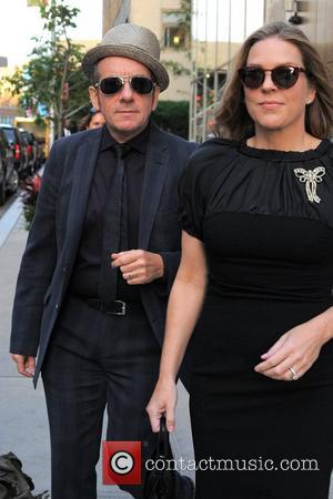Elvis Costello and wife Diana Krall heads to a their car outside the Trump Soho Hotel New York City, USA...