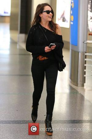 Game of Thrones' star Emilia Clarke  arrives at Los Angeles International Airport Los Angeles, California- 18.12.12