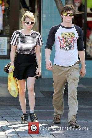 Emma Roberts and her boyfriend Evan Peters seen outside a Halloween store in West Hollywood Los Angeles, California- 26.10.12