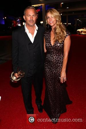 Kevin Costner, Christine Baumgartner 64th Annual Primetime Emmy Awards - Governors Ball at Los Angeles Convention Center Los Angeles. USA...