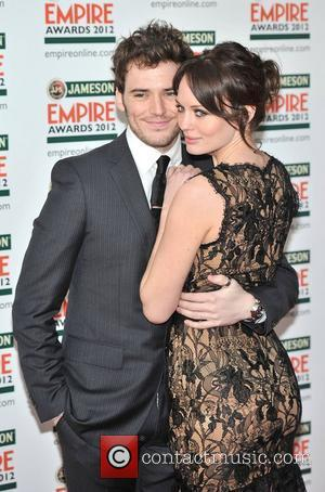 Laura Haddock and Sam Claffin The 2012 Jameson Empire Awards held at the Grosvenor House - Arrivals. London, England -...