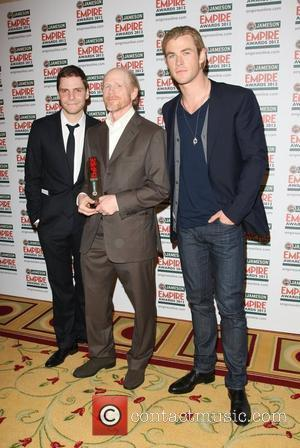 Daniel Bruhl, director Ron Howard with his Inspiration award and Chris Hemsworth The Empire Film Awards 2012- Press Room London,...