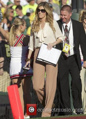 Erin Andrews at the Rose Bowl wearing taupe form-fitting slacks at the Oregon Ducks Vs.Wisconsin Badgers game at the Rose...