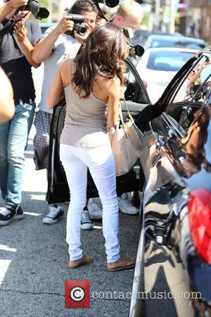 Eva Longoria  is surrounded by paparazzi photographers as she exits Ken Paves salon in West Hollywood.  Los Angeles,...