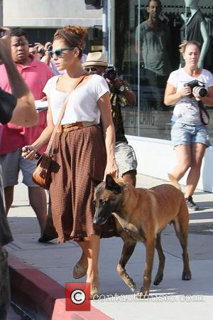 Eva Mendes leaving after a fittiing at fashion stylist Rachel Zoe's office with her Belgian Malinois dog called Hugo. Los...