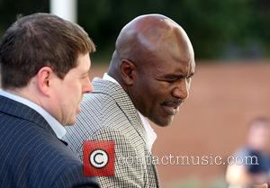 Evander Holyfield Ordered To Repay Child Support Debt