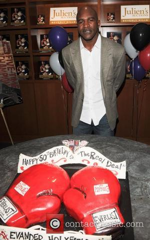 Evander Holyfield Seeks Court Order To Block Memorabilia Auction
