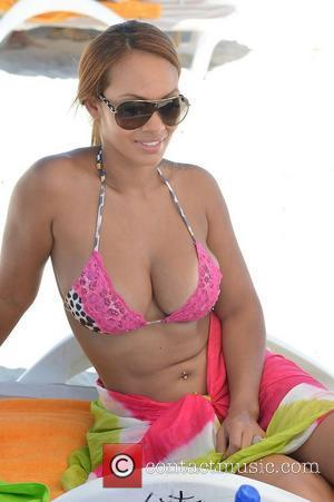 Evelyn Lozada's Wine Bottle Throwing Days Are Over