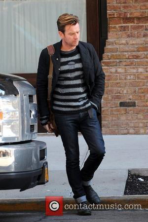 Ewan McGregor leaving his Manhattan hotel with turn up jeans and smoking a cigarette. New York City, USA - 24.01.12