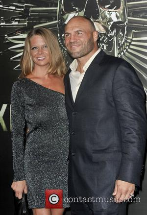 Randy Couture and Anne-Marie Stanley  The Los Angeles Premiere of The Expendables 2 at Grauman's Chinese Theatre. Hollywood, California...