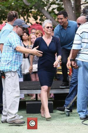 Jamie Lee Curtis and Mario Lopez Celebrities appear on 'Extra' at The Grove Los Angeles, California- 11.09.12