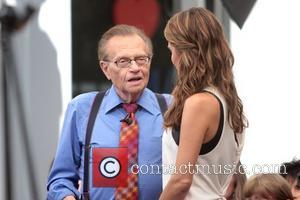Larry King and Maria Menounos