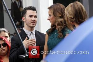 Kevin Jonas, Danielle Deleasa and Maria Menounos
