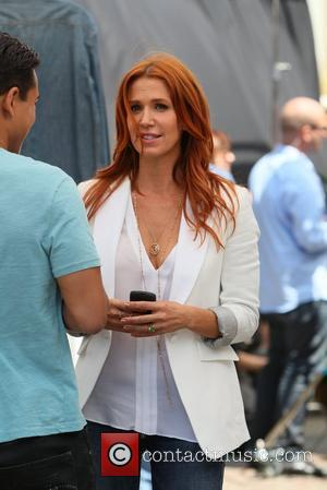 Poppy Montgomery and Mario Lopez
