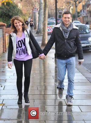 Harry Judd and girlfriend Izzy Johnston   arriving at Fearne Cotton's house for her Christmas Party  London, England...