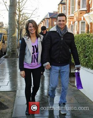 Harry Judd and girlfriend Izzy Johnston  leaving Fearne Cotton's house after her Christmas Party London, England - 22.12.11