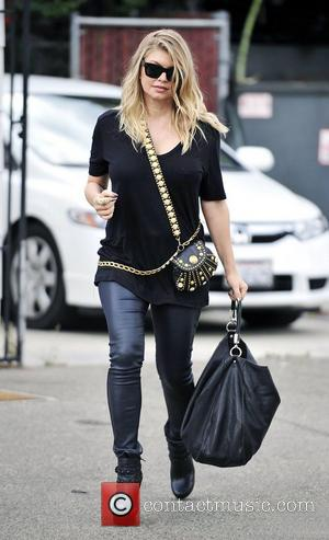 Black Eyed Peas singer Fergie, real name Stacy Ferguson, out and about wearing black with gold accessories Los Angeles, California...