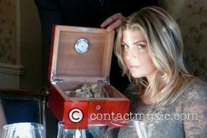 Fergie posted this picture of herself on Twitter with the quote, 'Mmmm. Nothing like the scent of #truffles.' USA -...
