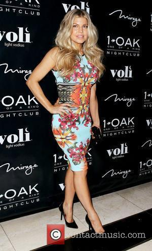 Fergie, aka Stacy Ferguson, La La Anthony and Kim Cattrall wore the same floral print dress. Who wore it better?...
