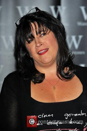 E. L. James signs copies of her...
