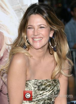 *file photo* * BARRYMORE ENGAGED DREW BARRYMORE is hoping to make it third time lucky after reportedly accepting boyfriend WILL...
