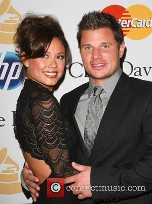 *file photo* * MINNILLO PREGNANT Former pop star NICK LACHEY and his new bride VANESSA MINNILLO are expecting their first...