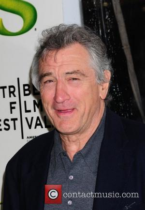 * DE NIRO A DAD AGAIN AT 68 ROBERT DE NIRO is a father again at the age of 68...