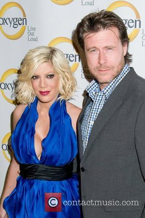 *file photo* * SPELLING PREGNANT AGAIN Actress-turned-reality star TORI SPELLING is pregnant again - just five months after giving birth...