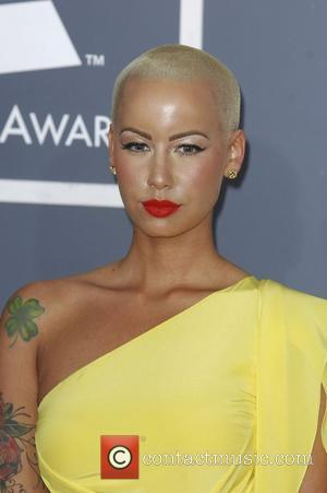*file photo* Rapper Wiz Khalifa and Amber Rose are engaged  Amber Rose  54th Annual GRAMMY Awards (The Grammys)...