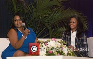 Gabby Douglas attends the iGlow Mentoring 'Pink Pearls and Pretty Dresses Girls Empowerment Brunch' as guest of honour Chicago, Illinois...