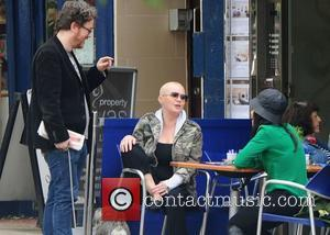 Gail Porter chatting to friends in Hampstead London, England - 12.07.12