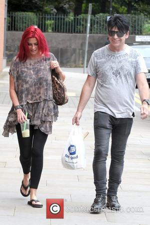 Gemma Numan and Gary Numan in good spirits as they return to their Manchester hotel Manchester, England - 27.07.12