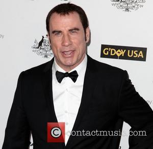 John Travolta Shrugs Off Gay Claims By Kissing Wife, Kelly Preston