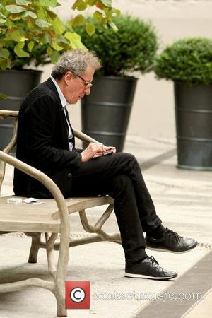 Geoffrey Rush texting on his cell phone as he sits outside his Manhattan hotel New York City, USA - 08.09.12