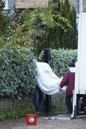 A bed being delivered to George Michael's house London, England - 21.12.11