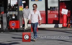 Gerard Butler stops a gas station in West Hollywood Los Angeles, California - 26.01.12