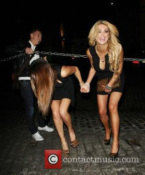 Natasha Giggs and Nicola McLean negotiate a heavy chain barrier at Gilamesh in Camden. London, England - 17.02.12