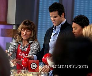 Debra Humphries and Kris Humphries Kris Humphries participates in a holiday cookie cooking segment with his mother on ABC's 'Good...