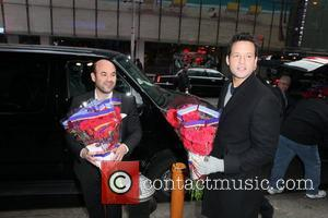 Ian Gomez and Josh Hopkins The stars of 'Cougar Town' hand out flowers for Valentine's Day to fans outside ABC...