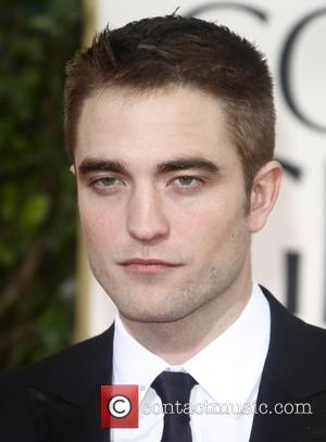 Robert Pattinson 70th Annual Golden Globe Awards held at the Beverly Hilton Hotel - Red Carpet  Featuring: Robert Pattinson...