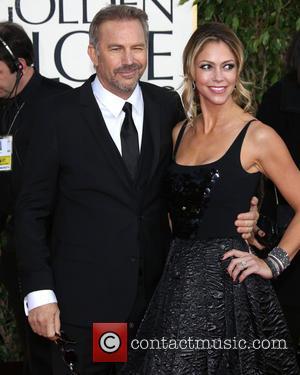 Kevin Costner, Christine Baumgartner and Beverly Hilton Hotel