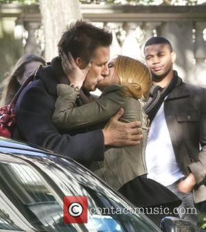 Billy Baldwin and Kaylee Defer kiss on the film set of Gossip Girl on Upper East Side New York City,...
