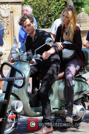 Blake Lively and Penn Badgley  ride a Vespa scooter on the set of 'Gossip Girl' in Central Park New...